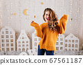 Surprised, cheerful girl happily laughs in cozy 67561187