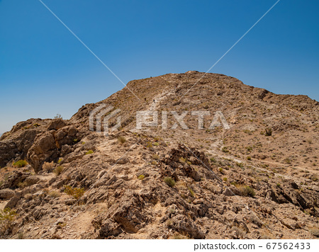 Sunny view of the landsacpe of Lone Mountain 67562433