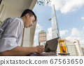 Asian businessman working outdoor the office 67563650