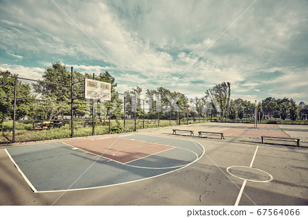 Retro toned picture of an empty basketball court 67564066