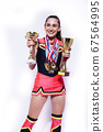 young smiling cheerleader girl with golden cups and price medals isolated on white background, lifestyle sport people concept 67564995