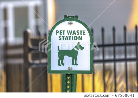 Close up of a Pet Waste Station with gate and 67568041