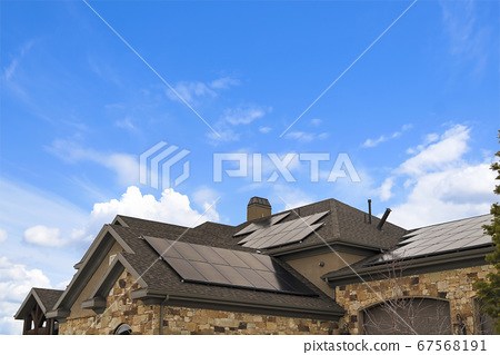 Cloudy blue sky over a home with solar panels on 67568191