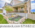 Exterior of a home with plants grasses and stones 67568212