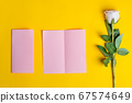 Folded bifold business pink card mockup with beautiful rose flower 67574649