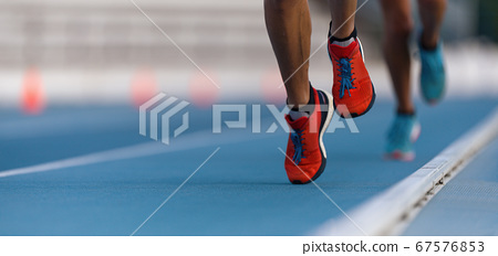 Athletes sprinters run speed on track of stadium 67576853