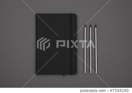Black leather cover notebook flat lay over grey 67584280