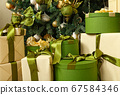Close up gift boxes under green Christmas tree 67584346