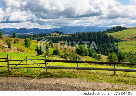 fence on the hill in rural area. early autumn 67584409