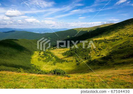 hills and valley of summer mountain landscape. 67584430