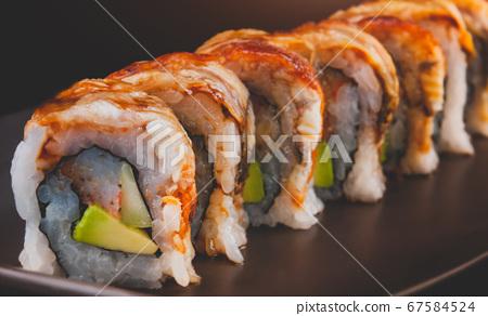 Unagi roll or Japanese grilled eel roll. 67584524