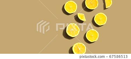 Fresh yellow lemons overhead view 67586513