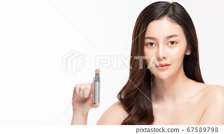 Beauty asian woman hold bottle cosmetic cream lotion  and cheerful. 67589798