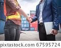 Businessman and Container Shipping Worker Handshake Together for Cooperation Shipment  67595724