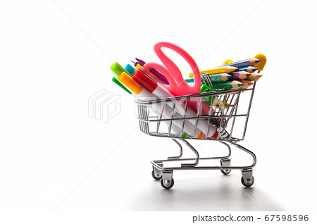 Shopping trolley filled with multicolored school 67598596