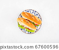 Baguette sandwich with tomatoes and cheese 67600596