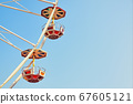 Retro toned close up picture of two Ferris wheel cars. 67605121