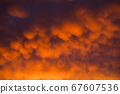Red clouds in the sky during the sunset 67607536