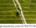 Aerial: The car on the pathway in the middle of agricultural field 67607538