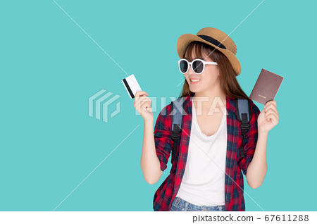 Beautiful young asian woman wear hat and sunglasses with showing credit card and passport to travel. 67611288