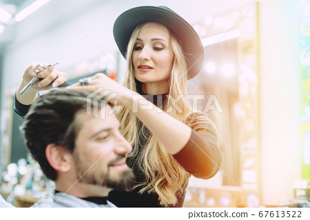 Hair stylist trying to get her client a proper cut 67613522
