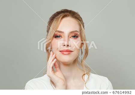 Perfect young woman face with clear healthy skin 67614992