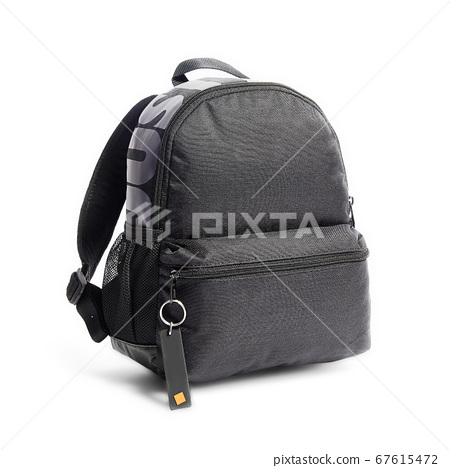 Men's Black Mini Backpack Isolated on White Background. Side View of Canvas Satchel with Zippered Compartment. Travel Camping Daypack. School Bag with Shoulder Straps and Haul Loop at the Top 67615472