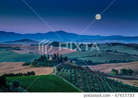 Scenic Tuscany landscape farmhouse in moonlight, Italy 67615783