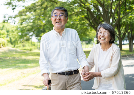 Senior couple walking in the park and rehabilitating 67615866