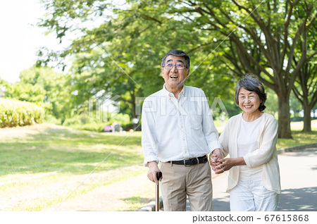 Senior couple walking in the park and rehabilitating 67615868