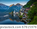 Classic view of Hallstatt with ship at sunrise, 67615976