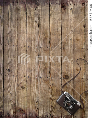 Wooden desk and analog camera 67619466