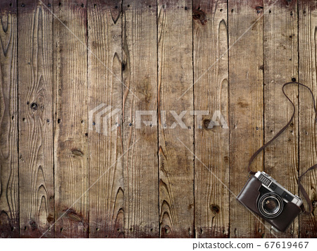 Wooden desk and analog camera 67619467