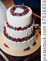Big white cake with fresh berries 67636656