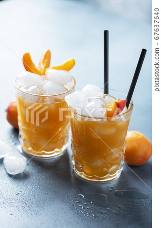 Summer juice with apricots and ice 67637640
