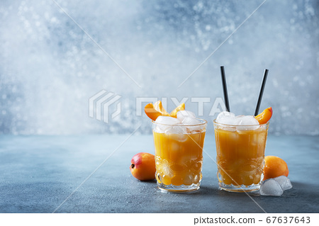 Summer juice with apricots and ice 67637643