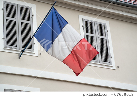 Closeup of french flag in historic building 67639618