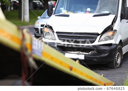 Car after an accident calls in on tow truck 67640825