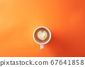 cup of coffee on orange background 67641858