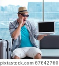 Young man travelling for his summer beach vacation 67642760