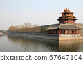 Forbidden City, Beijing, China. A corner tower seen from outside the Forbidden City. The Forbidden City has traditional Chinese architecture. The Forbidden City is also the Palace Museum, Beijing. 67647104