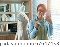 Happy young Asian woman dressmaker fashion 67647458