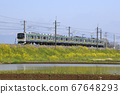 Paddy field in early summer and Tohoku Main Line Series 205 (former Keiyo Line vehicle) 67648293