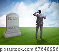 Businessman mourning the death of success 67648956