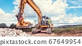 Woman construction worker with excavator on sit 67649954