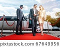 Couple arriving with limousine walking red carpet 67649956