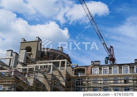 modern building under construction, plastered 67650070