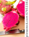 Dragon fruit (red meat) cut in half made in Vietnam 67653381