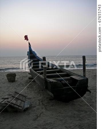 Sunset on Goa beach 67655743
