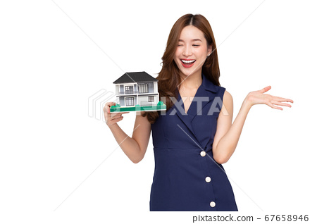 Young Asian woman smiling and holding house sample 67658946